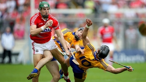 Clare's Pat Donnellan and John Conlon collide with Aidan Walsh of Cork