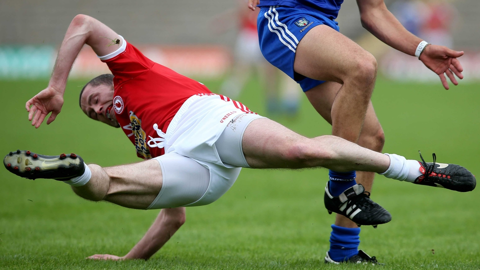 Stephen O'Neill of Tyrone is tackled during the Monaghan versus Tyrone Ulster Football Championship quarter-final