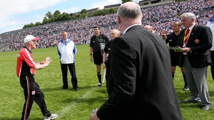 Tyrone manager Mickey Harte confronts referee Eddie Kinsella at the end of the Tyrone versus Monaghan tie