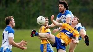 Clare's Barry Hartnett and Tommy Prendergast of Waterford battle for possession during the Munster SFC clash