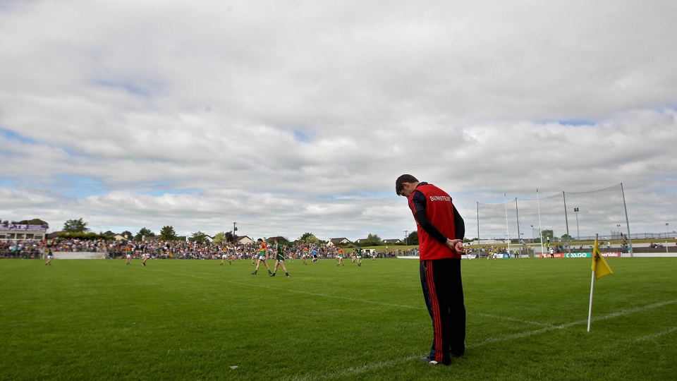 ... and Carlow manager Anthony Rainbow showing a similar dejection on the sideline near the end of the game...