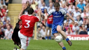 Dermot Malone's second-half goal was crucial as Monaghan progressed