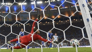 Asmir Begovic in the Bosnia and Herzegovina goal is unable to stop Lionel Messi's effort