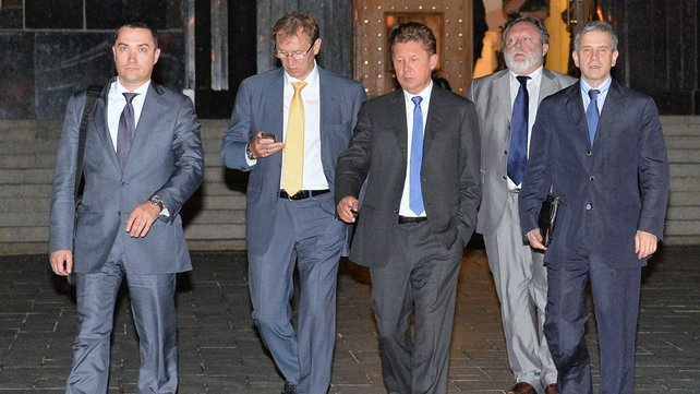 Head of Gazprom Alexei Miller (centre) leaves following a round of talks