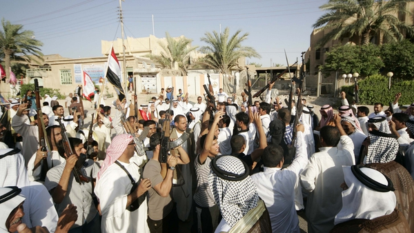 Iraqi volunteers fighting with Iraqi forces chant slogans in Karbala city, southern Baghdad