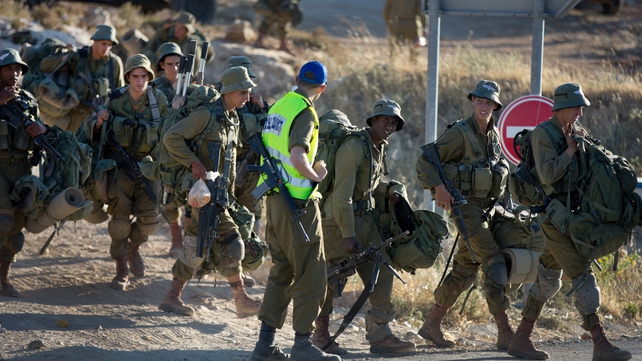 Israeli soldiers deploy near the West Bank town of Hebron