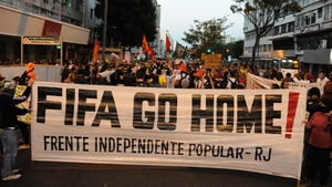 People demonstrate against the FIFA World Cup, in Rio de Janeiro near the Maracana stadium