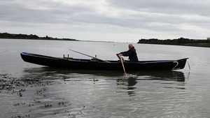 A lone rower makes his way across the bay (Pic: Lar Boland)