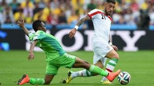Nigeria forward Ahmed Musa extends to challenge Iran forward Ashkan Dejagah
