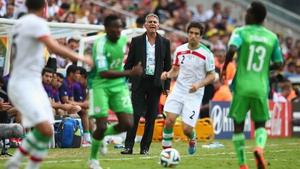 Iran head coach Carlos Queiroz looks on as forward Khosro Heydari drive the ball into Nigeria's side