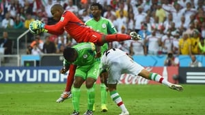 Enyeama dives ahead to secure the ball