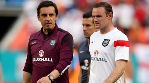 Gary Neville, an England coach, is a former team mate of Wayne Rooney