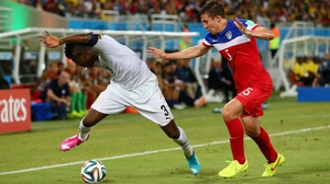 Ghana forward Asamoah Gyan and USA defender Matt Besler vied for the ball, in what proved to be a fast-paced, highly physical match