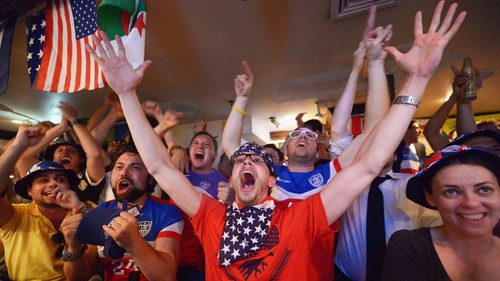 Soccer fans cheer for the US football team as they face Ghana in the World Cup at Jack Dempsey's Bar in New York