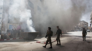 Israeli soldiers clash with Palestinian youth during the search for three missing teenagers in Hebron, West Bank