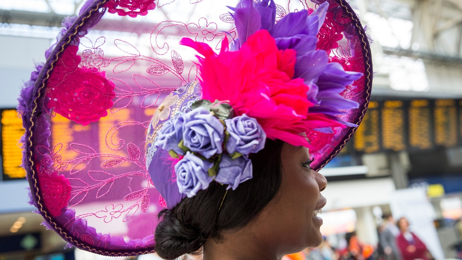 Racegoers travel from Waterloo station to attend the first day of the Royal Ascot races in London
