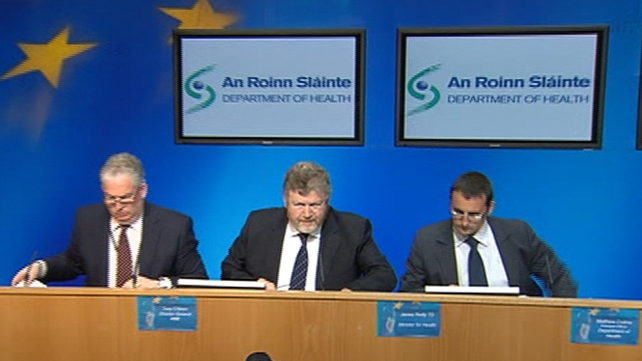 James Reilly (c) outlines the Government's stance on medical cards at a news conference this afternoon