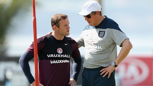 Wayne Rooney talks to Roy Hodgson during a training session at the Urca military base on Monday