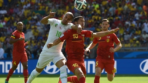 Algeria forward Sofiane Feghouli vies with Belgium midfielder Eden Hazard during the first half of the match, which saw Algeria play a disciplined, steady game, while Belgium seemed disjointed