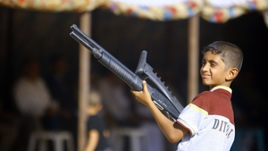An boy takes part in a gathering by Shiite tribesman to show their willingness to join Iraqi security forces