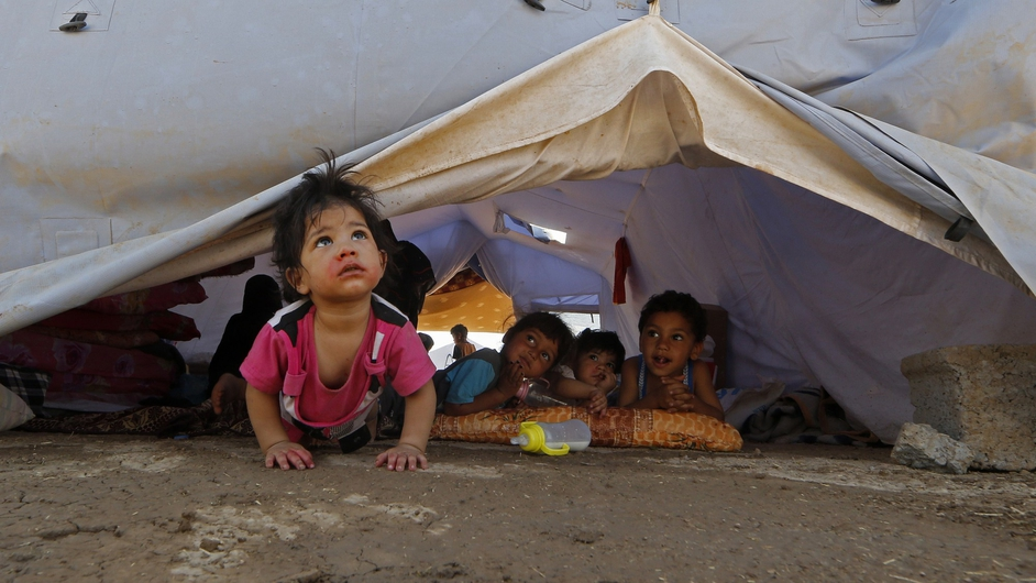 Displaced children set inside a UNCHR tent at a temporary camp set up to shelter people fleeing violence in northern Iraq