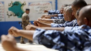 Newly-recruited Iraqi volunteers take part in a training session in the central Shiite Muslim city of Karbala