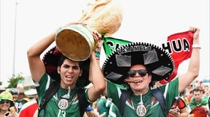 Fans of Mexico returned to the stands en masse, toting what might be the largest World Cup trophy ever sculpted or even conceived