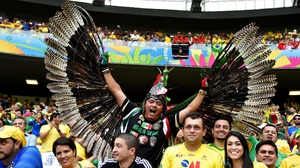 A Mexican winger watches his team take on Brazil in the World Cup