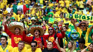 ... as supporters of Brazil and Mexico waited to cheer on the two leaders of Group A