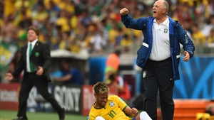Brazil coach Luis Felipe Scolari gestures toward a banged up Neymar, who couldn't translate his play-making energy into goal-scoring against the well-matched Mexican side
