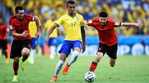 Mexico midfielder Hector Herrera, Brazil midfielder Luiz Gustavo, and Mexico forward Oribe Peralta, during the match which saw both teams split possession evenly down the line