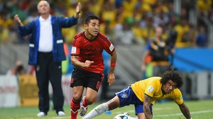 Scolari, equally frustrated, watches Mexico midfielder Marco Fabian beat Brazil defender Marcelo to the ball, as the final minutes tick by