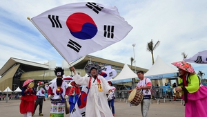 A Korea fan waved this massive flag on his way into the stadium