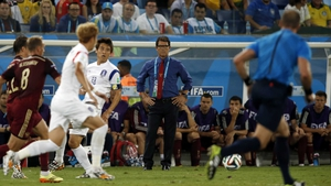 Russia coach - and former England coach - Fabio Capello watches the action with a look of dubious gloom