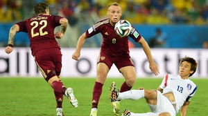 The first half saw only one shot on target, proving one of the slowest openings seen so far. Here, Russia midfielder Denis Glushakov and Korea forward Koo Ja-Cheol compete for the ball