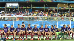 Russian players sit on the bench. Russia is the only squad of the 32 that selected exclusively domestic players to make the trip to Brazil