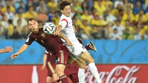 Doing little to smash the stalemate, Russia defender and captain Sergey Ignashevich and Korea midfielder and captain Lee Chung-Yong collide while watching the ball float serenely away