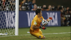 ... which Korea goalkeeper Jung Sung-Ryong properly wrapped up