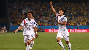 Korea forward Lee Keun-Ho (R) celebrates the goal, which drove the score to 1-0