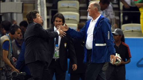 Brazil manager Luis Felipe Scolari and Mexico coach Miguel Herrera shake hands after the final whistle at Estadio Castelao