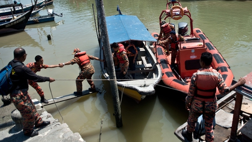 A search and rescue team returns from the rescue mission on the outskirts of Banting