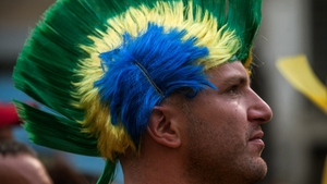 Fans attend a viewing of the World Cup match between Mexico and Brazil in Sao Paulo, Brazil
