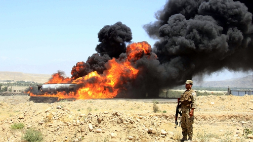A tanker carrying oil for NATO's forces explodes in Jalalabad, Afghanistan, killing at least two and injuring six