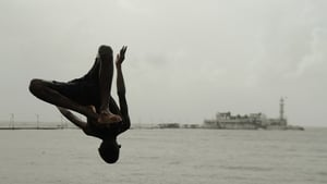 An Indian youth dives head first into the Arabian Sea in Mumbai