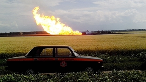 Flames dominate the skyline at Poltava, Ukraine, following an explosion at a national gas pipeline