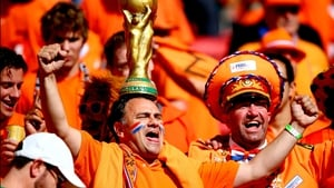 Here, a Netherlands fan shows off his quite classy, golden hat