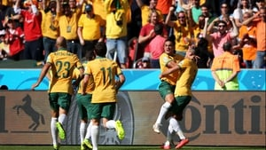 Cahill celebrates with his team-mates and fans. The goal was his second of the World Cup so far