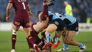 Ouch: Nate Myles of the Maroons is tackled by Anthony Watmough of the Blues during game two of the State of Origin series between the New South Wales Blues and the Queensland Maroons