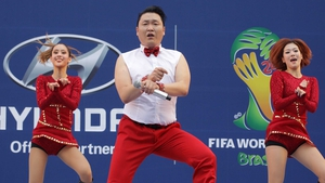 South Korean singer Psy performs during a public screening for the 2014 World Cup match between South Korea and Russia