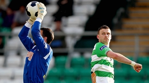 Shamrock Rovers' Ciaran Kilduff also none too pleased, this time with goalkeeper Mark McNulty of Cork City